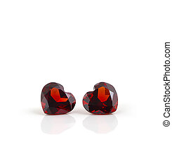 Couple of ruby heart gemstones isolated on white background