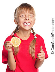 Little girl with lemon - Beautiful smiling little girl with...