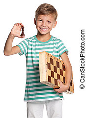 Boy with chessboard - Happy boy with chessboard isolated on...