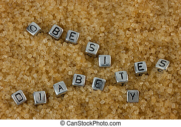 Obesity and Diabetes Concept - Letter tiles spelling out the...