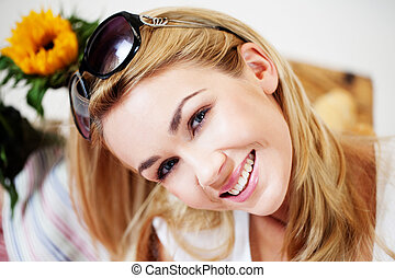 Smiling woman with sunglasses on her hair