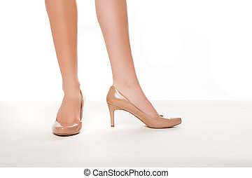 Woman in high heeled shoes