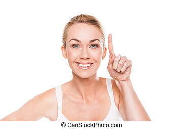 Smiling woman pointing with her finger