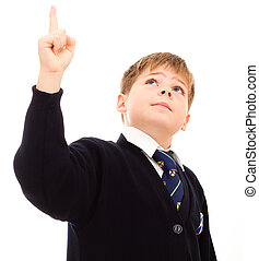 Schoolboy points upwards - Schoolboy in his uniform points...
