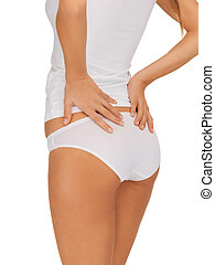 slimming concept - closeup picture of woman in cotton...