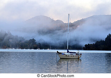 Whangaroa harbor New Zealand - Landscape of a small sailing...