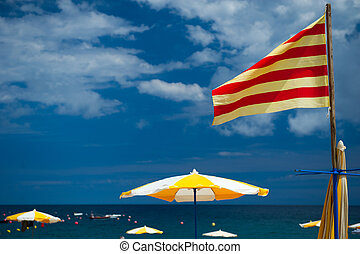 Catalan beach - Beach at the Costa Brava with Catalan flag