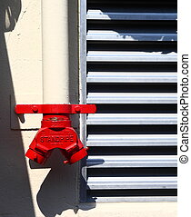 Standpipe - A red valve on a standpipe for use by the fire...