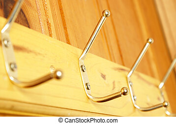 Coat Rack - A closeup shot of a wooden coat rack for storage...