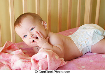 Baby Girl in Crib with hand to face - Little Baby Girl in...