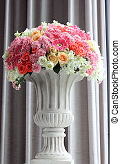 Arrange flowers in a vase - Arrange flowers in a white roman...