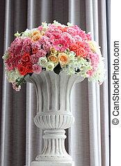 Arrange flowers in a vase - Arrange flowers in a white roman...