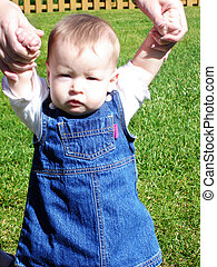 Baby Girl Learning to Walk - Little Baby Girl in jean dress...