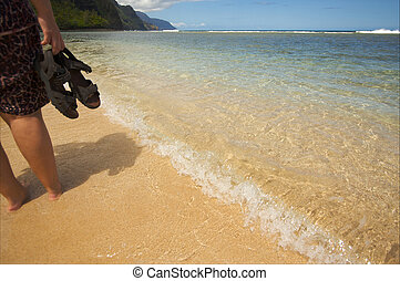 Woman Walking on Beaches of the Napali Shoreline, Kauai