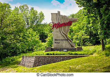Minnesota State Sign in Summer with Green Foliage and Blue...