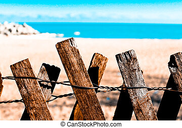 Fence blocking the beach - A fence blocking access to an...