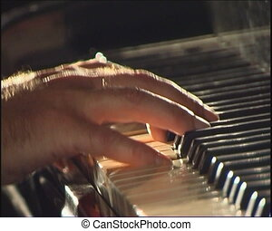 Piano keyboard. - Older hands playing the piano.