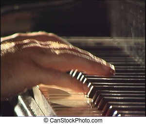 Piano keyboard - Older hands playing the piano