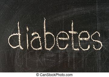 The word diabetes handwritten with chalk  on a blackboard
