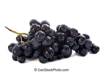 black grapes - black muscat grapes in front of white...