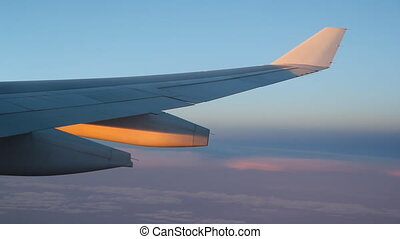 Dusk flight. Gold and purple light. - Passenger jet in...