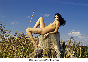 Naked young woman in the park.