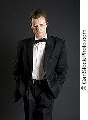 Man in black dinner jacket with bow tie