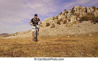 mountain biking - man rifing the mountain bike