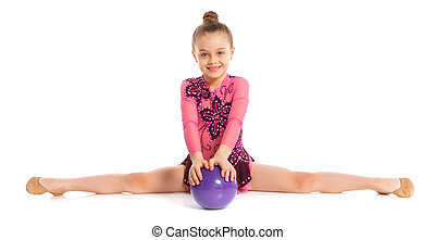 Little gymnast with ball on a white background. Sporting...