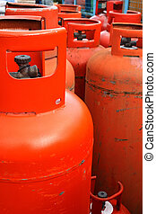 Domestic propane gas bottles ready to be refilled and...