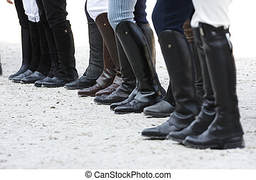 riding boots - Jockeys wearing black leather riding boots