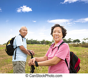 asian Senior couple hiking in countryside