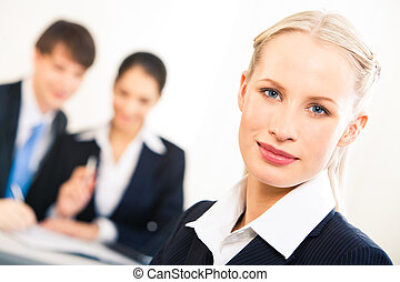 Professional - Portrait of blonde businesswoman looking at...