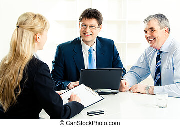 Communicating - Image of confident businessmen looking at...
