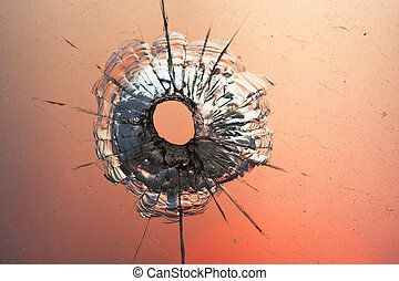 bullet hole in glass - bullet hole in window on the...