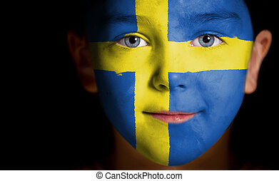 Portrait of a child with a painted swedish flag, closeup