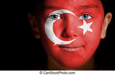 child with a painted turkish flag - Portrait of a child with...