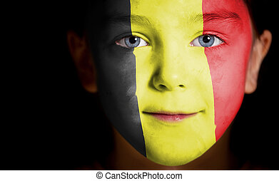 Portrait of a child with a painted Belgian flag, closeup