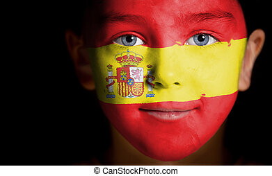 Portrait of a child with a painted Spain flag, closeup