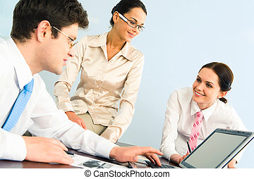 Working hours - Business-team of three smiling people...