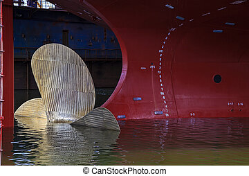 Big propeller - Close up of a Ship Propeller in water.