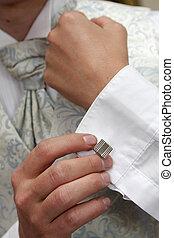 Cufling - A groom putting on his cuflings