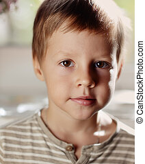 portrait of a boy - on an abstract background of a close up...