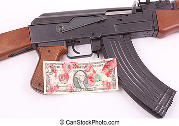 AK-47 with a bloodstained one-dollar bill