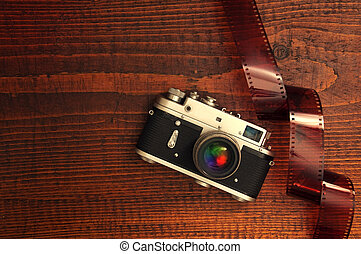Retro style camera on a wooden table plate with some 35...
