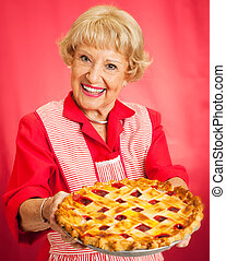 Grandmas Homemade Cherry Pie - Sweet grandmother in vintage...