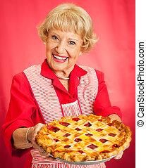 Grandmas Homemade Cherry Pie - Sweet grandmother in vintage...