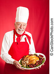 Chef Serves Holiday Dinner - Chef holding a Thanksgiving or...