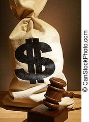 Legal Expenses - A bag of money and gavel represent many...