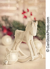 Rocking horse  - Wooden rocking horse on white table